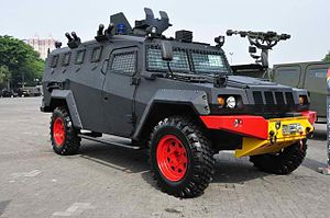 Pindad - A Pindad Komodo at Indodefence 2012 with red and yellow markings BRIMOB vehicle.