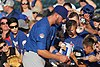 Kris Bryant signing autographs during his rehab assignment against Omaha (44315154651).jpg