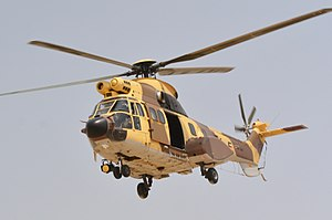 Kuwait Air Force - A Super Puma, helicopter drops off troops during Operation Eagle