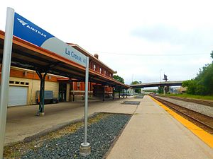 La Crosse station - The station at La Crosse in August 2016. The former Milwaukee Road depot is on the left while the bridge for U.S. Route53 northbound is in the distance.