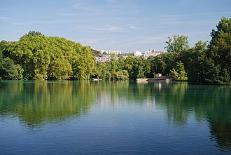 Parc de la Tête d'or - The lake at the centre of the park, looking towards the war memorial on the Île aux Cygnes