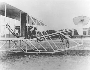 Frank P. Lahm - Frank Lahm (hand on upright by gas tank) with Orville Wright qualifying Signal Corps No. 1, July 27, 1909.