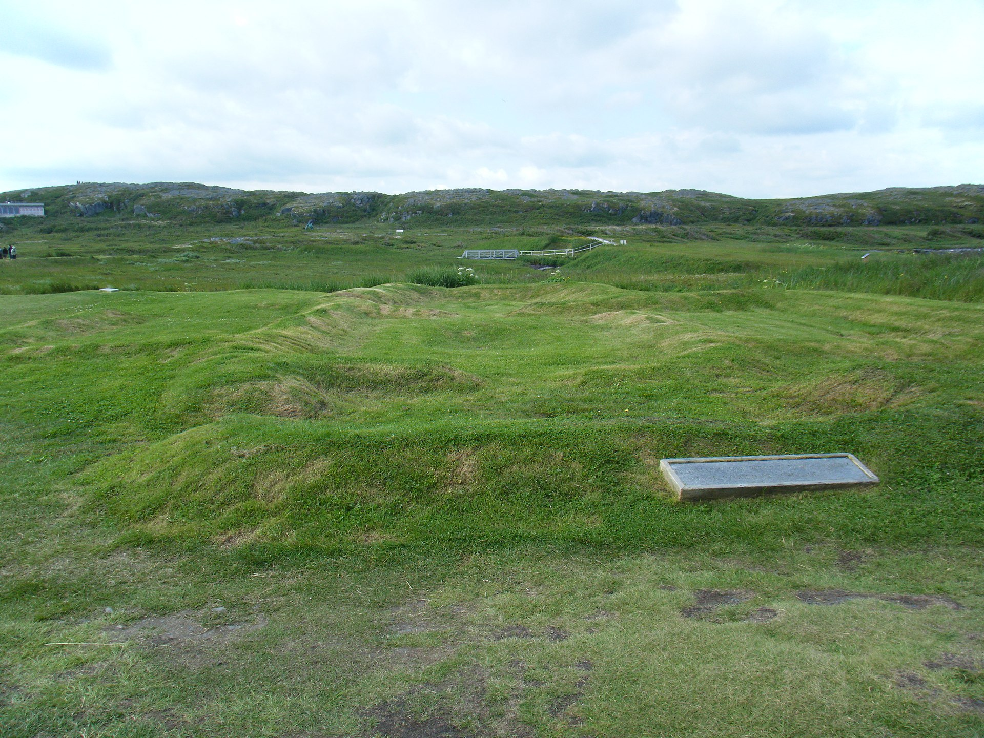 Photo of L'Anse aux Meadows on a sunny day in 2010. Photo: Remains of Norse settlement building, 2010 (building A) by Clinton Pierce is licensed under CC BY-SA 3.0