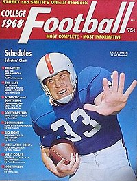Color rendering of 1968 cover of Street & Smith magazine, showing a close-up of football player Larry Smith in the royal blue, white and orange uniform of the Florida Gators, carrying a football in one hand with the other outstretched toward the camera.
