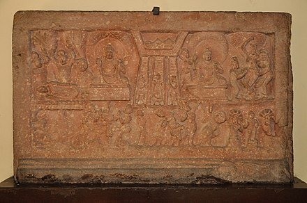 Life scenes of Buddha, sandstone: Birth, Enlightenment, Descent from Heaven, First Sermon, Passing Away, c. 2nd century CE, Government Museum, Mathura. Life Scenes of Buddha - Birth-Enlightenment-Descent from Heaven-First Sermon-Passing Away - Circa 2nd Century CE - Rajghat - ACCN 00-H-1 - Government Museum - Mathura 2013-02-23 5843.JPG