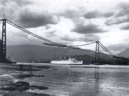 Lions' Gate Bridge with deck under construction from the span's center Lions' Gate Bridge 1938.jpg