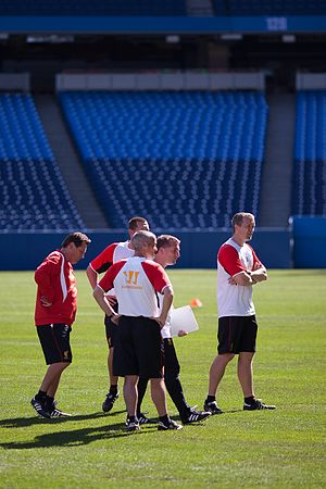 Coach (sport) - The coaching team of the Liverpool Football Club monitoring players during a training session