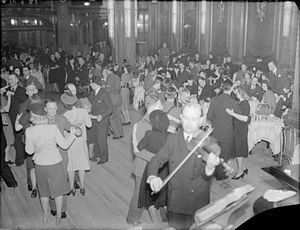 Tea dance - A tea dance in progress somewhere in the West End of London, a violinist plays in the foreground, spring 1941