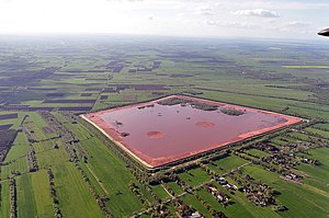 "Bauxite tailings - ""Red mud"" storage facility in Stade, Germany. The aluminium industry generates over a hundred million tons of this waste annually."