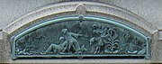 A turquoise-tinted bas-relief of a man stooping to aid another