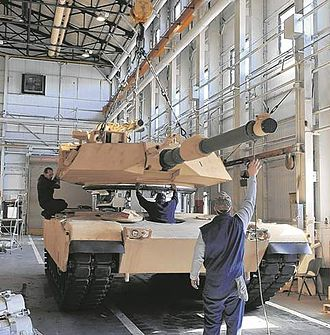 Anniston Army Depot - Mechanics at Anniston Army Depot line up an M1 Abrams turret with its hull.