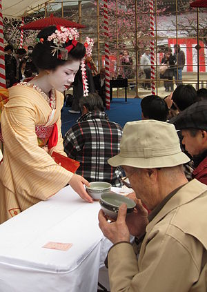Kitano Tenmangū - A maiko serving tea at the plum blossom festival.