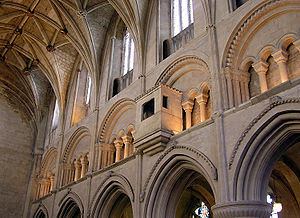 Triforium - Malmesbury Abbey, Malmesbury, Wiltshire, England showing the triforium,  with its rounded arches and chevron mouldings, each arch supported by four small arches on columns.