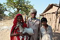 Mandu, local family with goat (9840376214).jpg