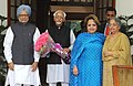 Manmohan Singh with his wife Smt. Gursharan Kaur greeting the Vice President, Shri Mohd. Hamid Ansari on his 75th birth anniversary, in New Delhi. Wife of the Vice President, Smt. Salma Ansari is also seen.jpg