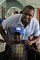 Mathias Kiwanuka with Ugandan child.jpg