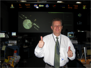 Matt Mountain - Matt Mountain gives two thumbs up at NASA's Johnson Space Center during Hubble's Servicing Mission 4 in 2009.