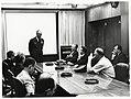 Mayor John F. Collins listening to unidentified speaker at USAF School of Aerospace Medicine (10290638865).jpg