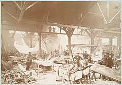 Men in a workshop hammering sheets of copper for the constr....jpg
