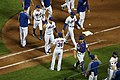 Mets high-five after win, July 13, 2018.jpg