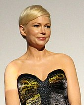 An upper body shot of Michelle Williams as she looks away from the camera