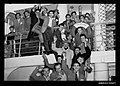 Migrants in a group on the MV TOSCANA at Trieste January 1954 (8402698533).jpg