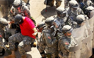 Tennessee Military Department - Tennessee Army National Guard soldiers conduct riot gear training.