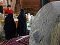 Millstone with Customers in Spice Shop - Bazaar - Kashan - Central Iran (7453838218) (2).jpg