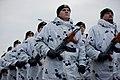 Ministru prezidents Valdis Dombrovskis vēro Nacionālo bruņoto spēku vienību militāro parādi 11.novembra krastmalā (6357912847).jpg