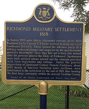 "Richmond, Ontario - Monument on Perth Street (main street) in Richmond Ontario Canada describing the history of Richmond.  The title is ""Richmond Military Settlement 1818""."