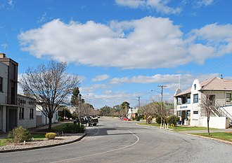 Moulamein - Morago Street, the main street of Moulamein, with the former Royal Hotel on the left and the Tattersalls Hotel on the right