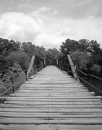 Mena, Arkansas - The Mountain Fork Bridge, eleven miles southwest of Mena, is listed on the National Register of Historic Places