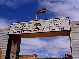 Saharan Spanish - Western Sahara and former colonial power Spain (above) and frequent source of expatriate education Cuba (mid). A sign welcomes visitors to the People's Liberation Army Museum, a military museum in the Sahrawi refugee camps, in Arabic and Spanish.