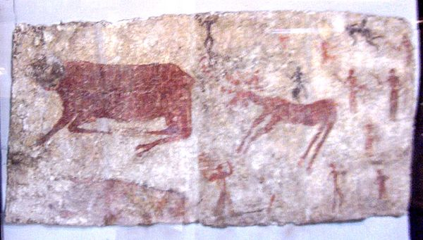 Mural of aurochs, a deer, and humans in Catalhoyuk, which is the largest and best-preserved Neolithic site found to date. It was registered as a UNESCO World Heritage Site in 2012. Museum of Anatolian Civilizations003.jpg