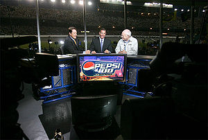 Fox NASCAR - Chris Myers (left) and Jeff Hammond (center) appear on the studio set alongside Vice President of the United States Dick Cheney (right) during the 2006 Pepsi 400.