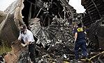 NTSB investigators Clint Crookshanks and Steve Magladry examining wreckage from UPS flight 1354 (9518979864).jpg