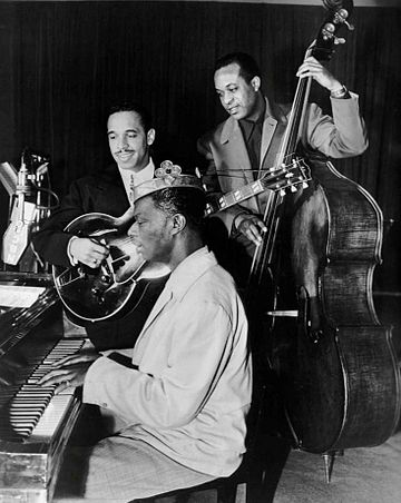 King Cole Trio Time on NBC with Cole on piano, Oscar Moore on guitar, and Johnny Miller on double bass, 1947 Nat King Cole Oscar Moore Johnny Miller King Cole Trio 1947.JPG