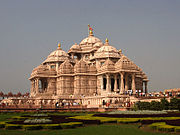 A complete view of Akshardham temple with people entering the temple.
