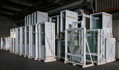 New glass doors and windows in storage.jpg