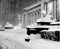 """""""Patience"""" and """"Fortitude"""": the """"Library Lion"""" statues; New York Public Library with mantle of snow (record snowfall of Dec. 1948)"""