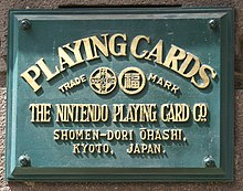Former headquarter plate from when Nintendo was solely a playing card company.