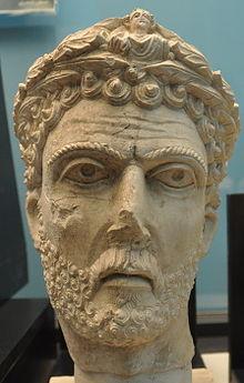 Bust of a bearded man wearing a wreath