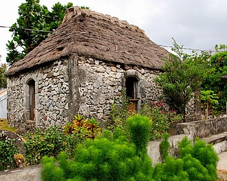 Batanes - A Sinadumparan Ivatan house, one of the oldest structures in the Batanes islands. The house is made of limestone and coral and its roofing of cogon grass.