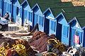 Olhos De Agua - fishermen's blue huts (13399629264).jpg