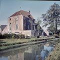 Overzicht, zijgevel van de toren en voorgevel tuinmanswoning voor de herbouw en verhoging - Bunnik - 20375166 - RCE.jpg
