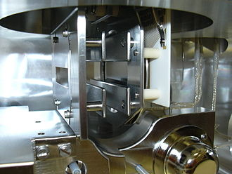 Microchannel plate detector - A microchannel plate within a Finnigan MAT 900 sector mass spectrometer position-and-time-resolved-ion-counting (PATRIC) scanning array detector