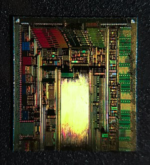 Power management integrated circuit - A PMIC on the inside. This is a die shot of an Apple 338S1164 PMIC manufactured by Dialog Semiconductors.