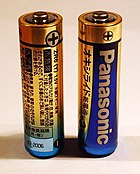 A pair of AA cells. The + sign indicates the polarity of the potential differences between the battery terminals.