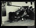 Passenger lying a deck chair, smoking a pipe (7626018516).jpg