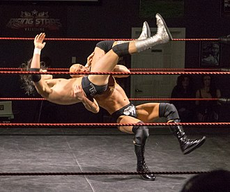 Suplex - Pepper Parks (bottom) performing a belly-to-back suplex on RJ City.